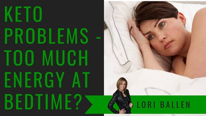 woman is awake in bed looking annoyed like she has too much energy to sleep maybe insomnia