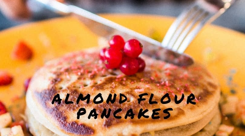 Stack of almond flour pancakes topped with a few berries - keto recipe low carb