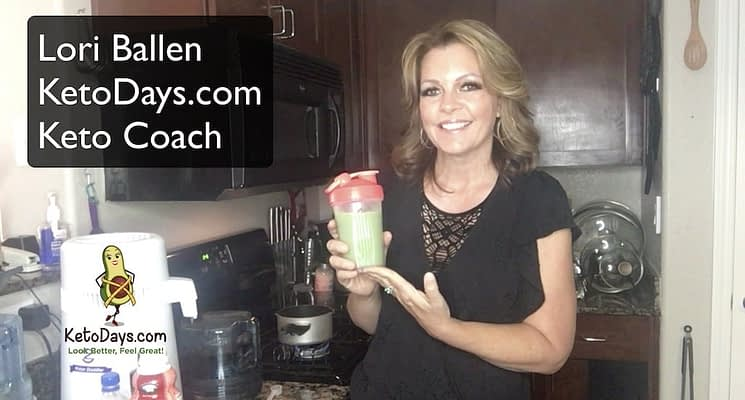 Lori Ballen Keto Coach is holding up her Keto Shake and smiling