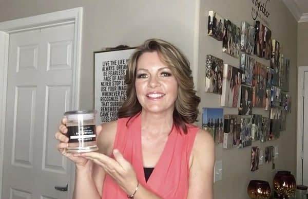 Lori Ballen keto Coach holds up a sample of sole water for the Keto Diet