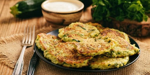 Add some delicous fat to your keto meal with these delicous Zucchini Fritters. Simply grate your Zucchini, fry, or air fry and season to perfection!