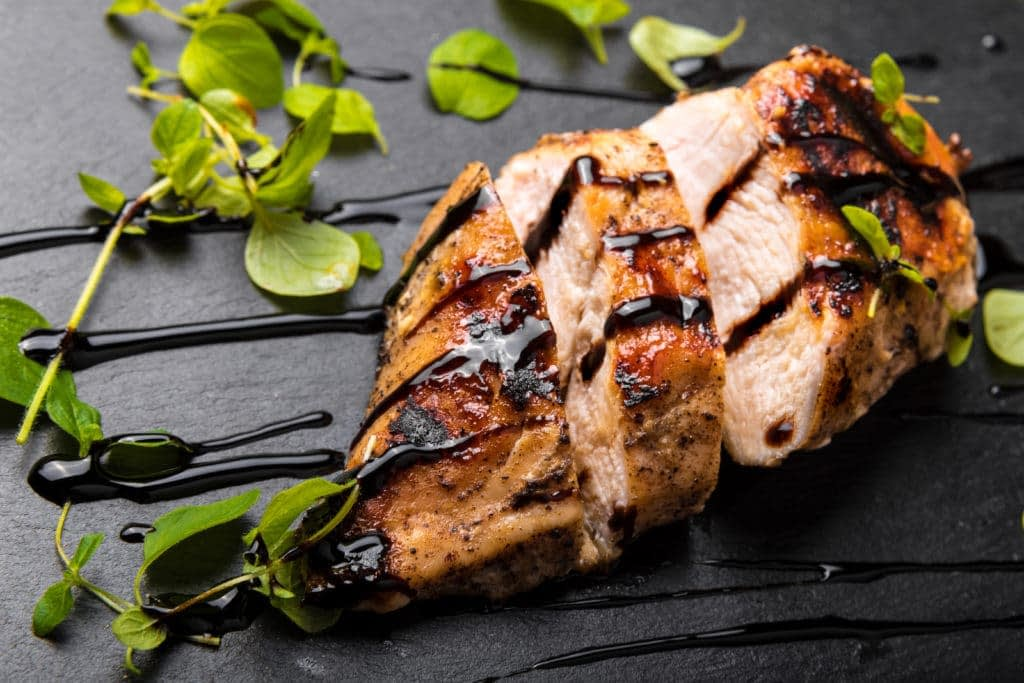 Protein is depicted in the form of a chicken breast with drizzled oil (a healthy fat)