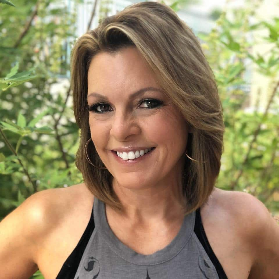 Lori Ballen Keto Coach is outside in Las Vegas, Smiling, and showing fit shoulders