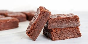 """This delicious keto chocolate fudge Brownie recipe is perfect for a birthday or dessert for any occasion. The MCT Oil, Collagen, and Protein Powder are all optional. It originally started out as a """"cake"""" but became brownies."""
