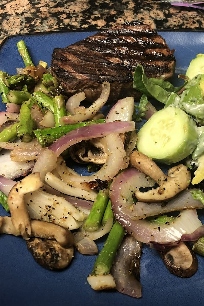 My second meal was at 5 and it was filet mignon, mixed asparagus, onion, musroom fry, and a small salad with cucumber and avocado.