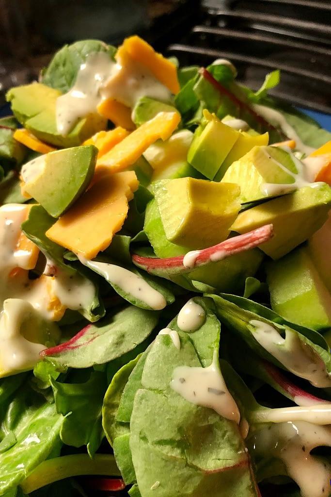 MY KETO SALAD has spring mix, cheese, cucumber, and avocado