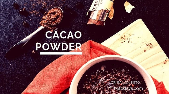 Cup of cacao beans and a spoon full of cacao powder with lori ballen keto and ketodays.com